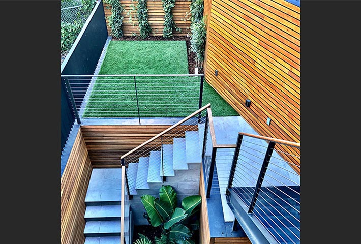 Landscaping for modern appartment patio with wooden and metal structures for grass and plants in Sam Francisco