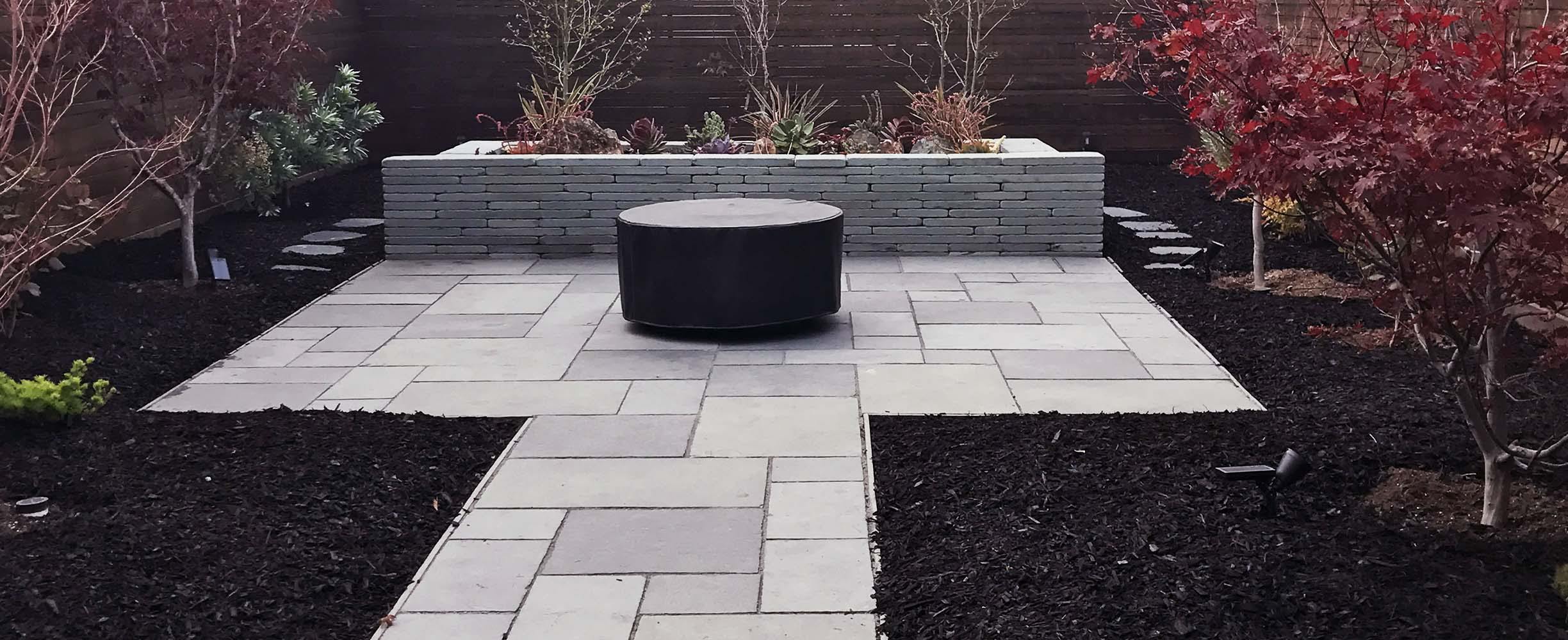 landscaping project in San francisco with stones path and a stone water fountain feature.